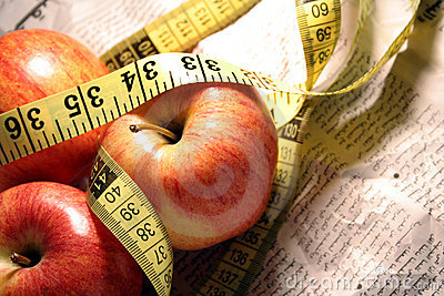 Red apples with measuring tap