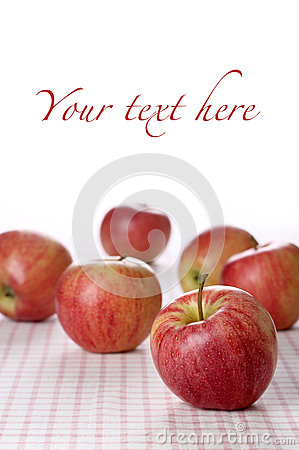 Red apples on tablecloth