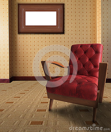 Red arm chair in living room with picture frame on