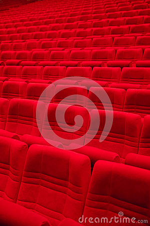 Red arm-chairs in empty hall