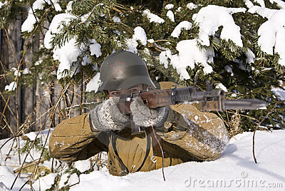Red Army soldier aims from a rifle