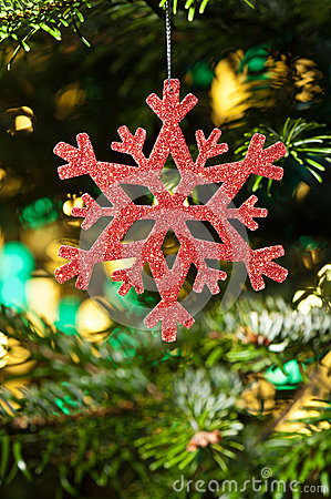 Red artificial snow flake in a christmas tree
