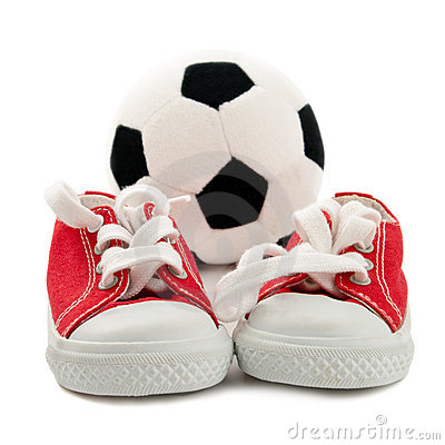 Red baby sneakers with a ball