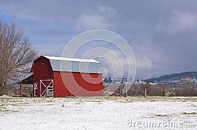 Red barn, blue sky, white snow.