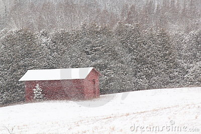 Red barn in snow blizzard