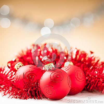 Red baubles with shiny tape in background