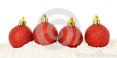 Red baubles on snow