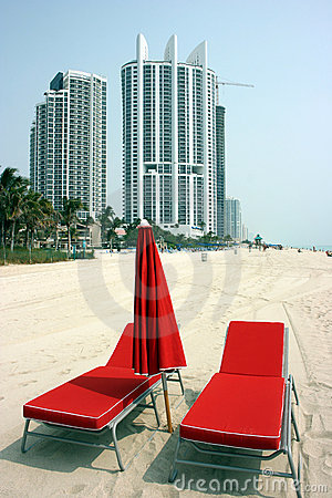 Red beach chairs and umbrella