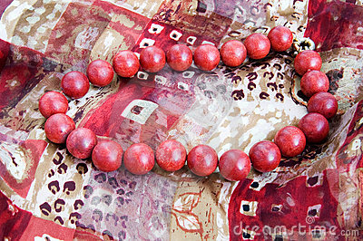 Red bead necklace on a silk scarf