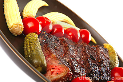 Red beef meat served with corns