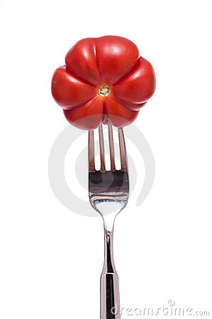 Red beef tomato on a fork