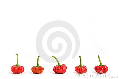 Red bell peppers in row