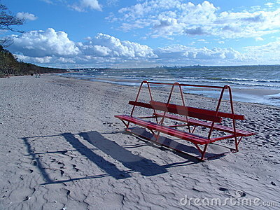 Red bench on the beach