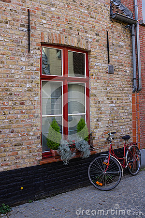Red bicycle on the street of Bruge Stock Photo