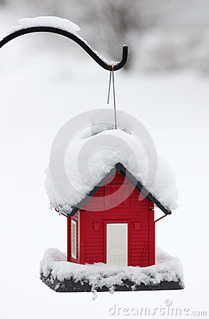 Red Birdhouse in the White Snow