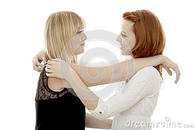 Red and blond haired girls are happy together