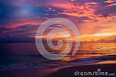 Red blue dark sky in the morning beach