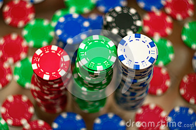 Red, blue, green and black casino tokens