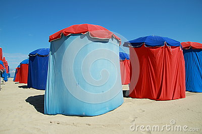 Red and blue parasols on beach