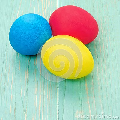 Free Red, Blue, Yellow Easter Eggs. Three Multicolored Handmade Easte Royalty Free Stock Images - 111472479