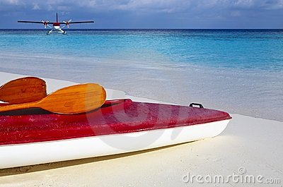 Red boat is on a beach 2