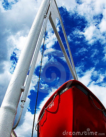 Red boat and blue sky