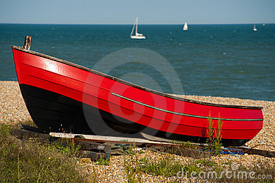 Red boat resting in the sunshine