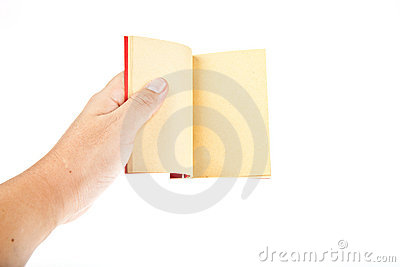 Red book open with hand