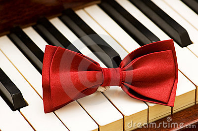 Red bow tie on the piano