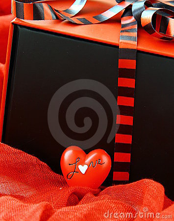 Red box with a gift and a red heart