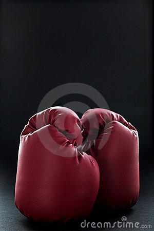 Red boxing gloves on black