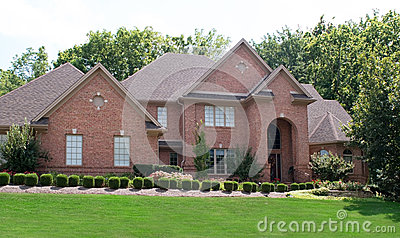 Red Brick House With Shrubs Royalty Free Stock Image