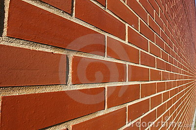 Red bricked wall in perspective