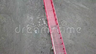 Red Bridge. Samut Sakhon/Thailand - 2018-08-31: Bird`s eye view above a red wooden bridge crossing the mangrove forest stock footage