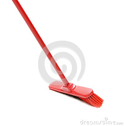 Red broom for cleaning.