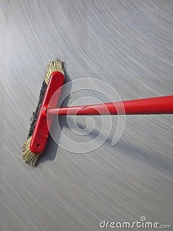 Red broom sweeping