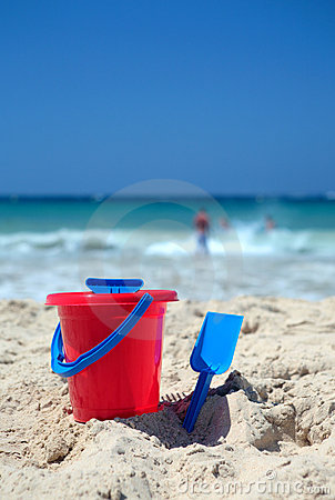 Free Red Bucket And Blue Spade On Sunny Sandy Beach Stock Photography - 1856832