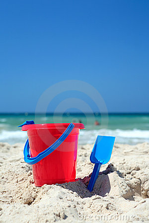 Free Red Bucket And Blue Spade On Sunny, Sandy Beach Royalty Free Stock Photos - 1856908