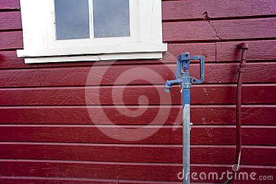 Red building blue faucet.