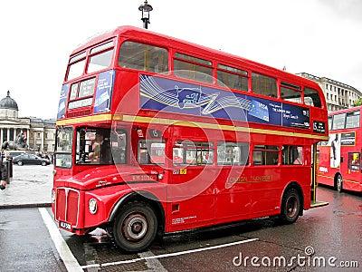 Red Bus in Trafalgar Square London Editorial Stock Image