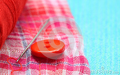 Red button on a cotton cloth