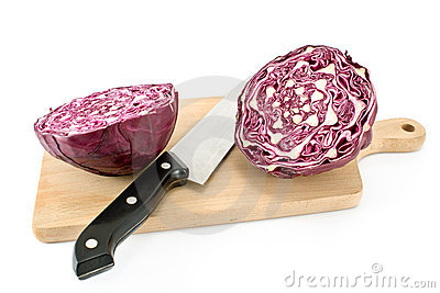Red cabbage with knife and cutting board