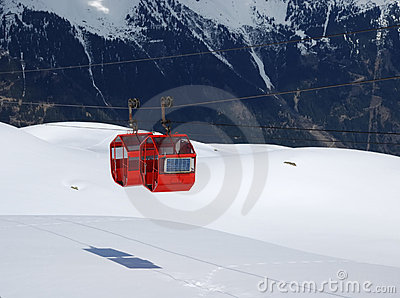 Red cabins of cable-way against mountain