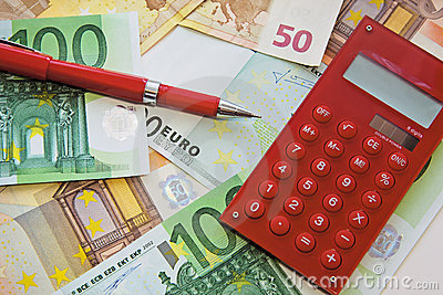 Red calculator and pen on banknotes background