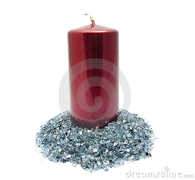 Red candle on blue glitter