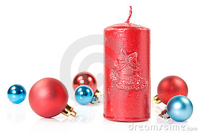 Red   candle and christmas baubles