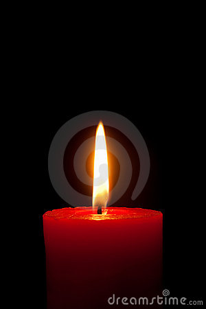 A red candle in front of black background