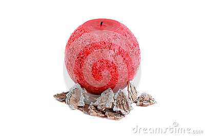Red candle isolated on white and Christmas decoration