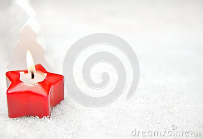 Red candle in the snow