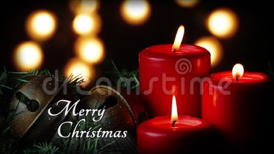 "Red Candles Merry Christmas Loop. Greeting, ""Merry Christmas"" is displayed in this seamless loop featuring three large flickering red pillar candles stock footage"